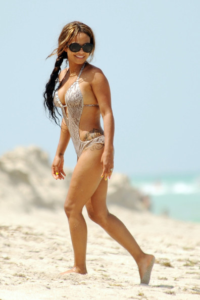 Christina Milian Hits The Beach In Snakeskin Monokini