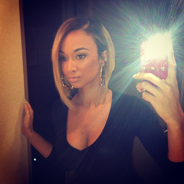 Raven Symone Shows Off Pastel Purple and Grey Bob Hairstyle