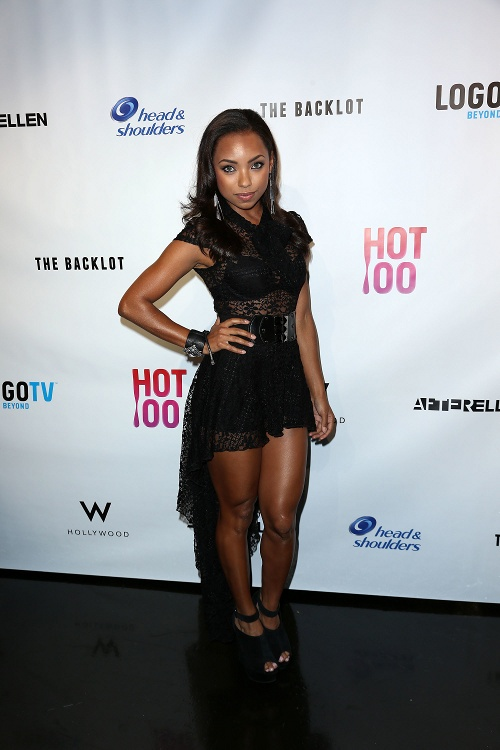Black Celebrity Style - Logan Browning Works It In Sheer Black High - Low Dress