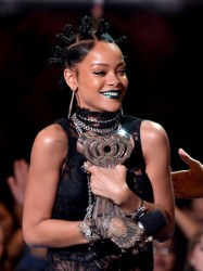 Rihanna's Green Lipstick and Mini Bun Hairstyle Combo