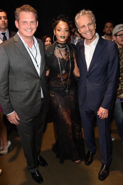 Rihanna's Green Lipstick and Mini Bun Hairstyle Combo 2