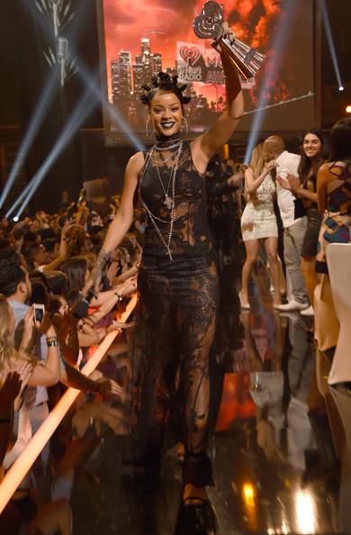 Rihanna's Green Lipstick and Mini Bun Hairstyle Combo 4