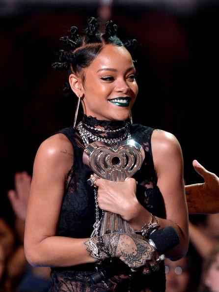 Rihanna's Green Lipstick and Mini Bun Hairstyle Combo