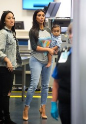 Kim K Looks Chic Carrying Baby North at Airport