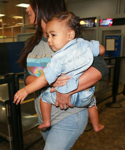 Kim K Looks Chic Carrying Baby North at Airport 3