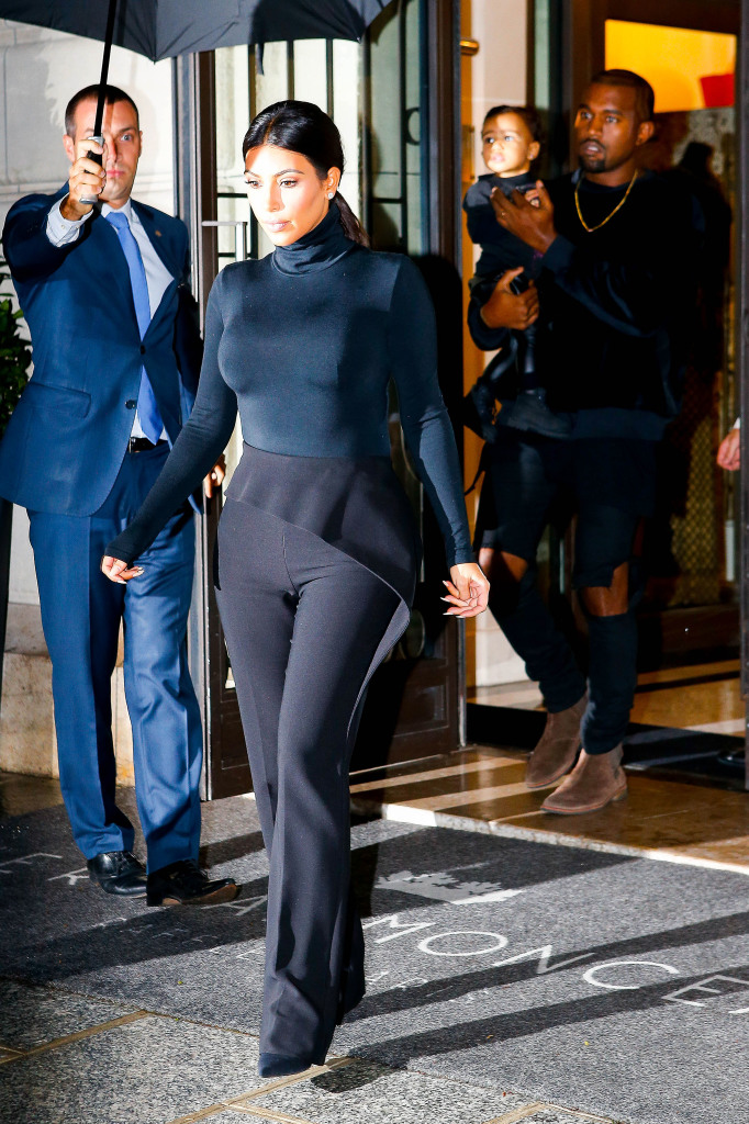 Kim Kardashian, Kanye West and North are a united family dressed in all black **USA ONLY**