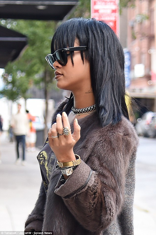 Rihanna is Back To A Shorter Mane & Bangs Hairstyle 2