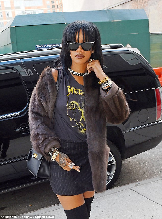 Rihanna is Back To A Shorter Mane & Bangs Hairstyle