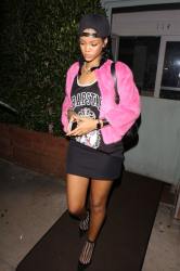 Rihanna is pretty in pink as she returns to her favorite dinner spot