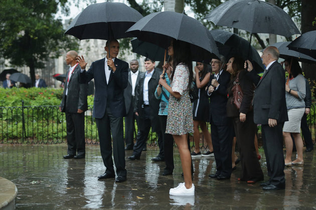HAVANA, CUBA - MARCH 20: U.S. President Barack Obama (2nd L) his daughter Malia (C), 17, and and other members of the first family pause to look at a statue of Cuban independence hero Carlos Manuel de Cespedes during a walking tour of in the plaza of the 18th century Catedral de San Cristobal de la Habana in the historic Old Havana neighborhood March 20, 2016 in Havana, Cuba. Obama is the first sitting president to visit Cuba in nearly 90 years. (Photo by Chip Somodevilla/Getty Images)